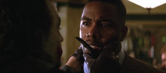 Heath Ledger (The Joker) kills gang leader Michael Jai White (Gambol).