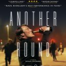 Mads Mikkelsen has a drink in the Another Round trailer